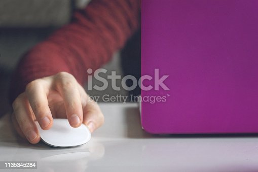 istock Man hands working on modern laptop. Developing programming and coding technologies. Website design. Programmer working in office, co-working. 1135345284