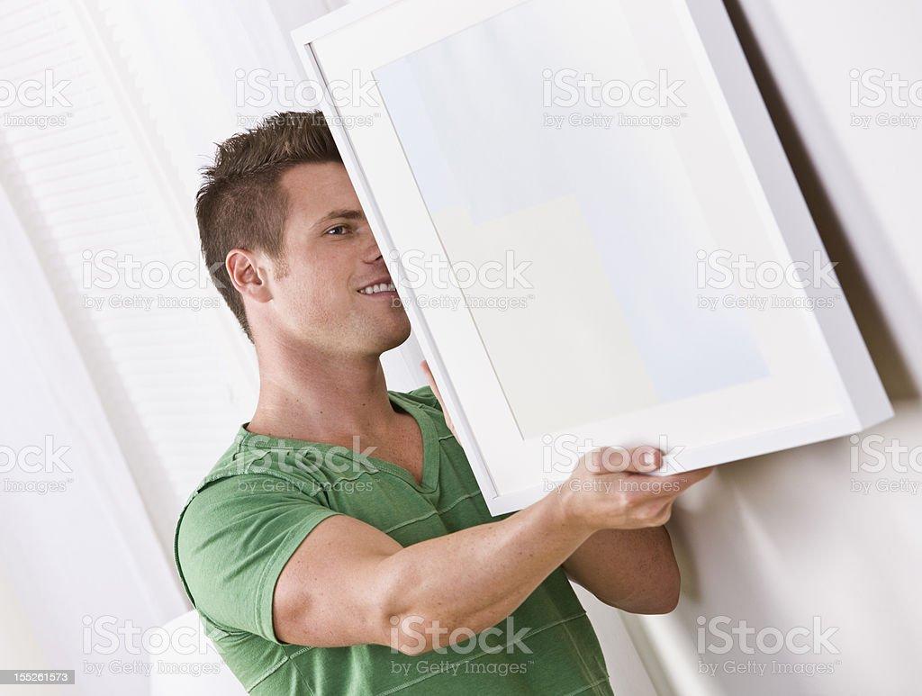 Man Hanging Frame stock photo