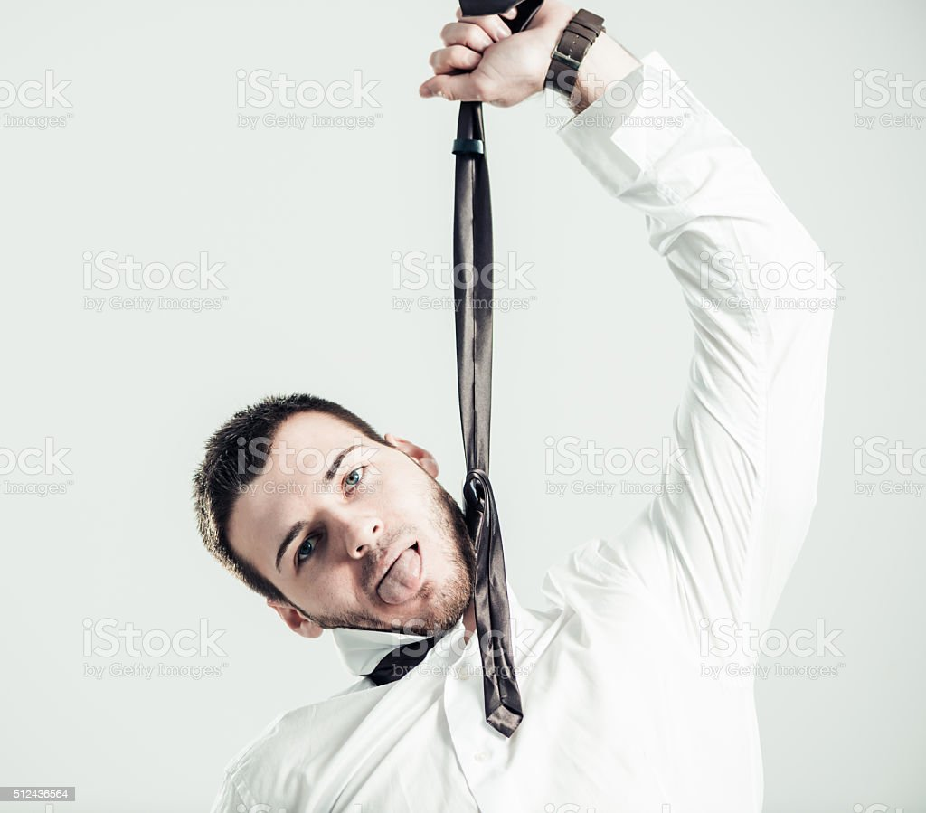man hanging on tie stock photo