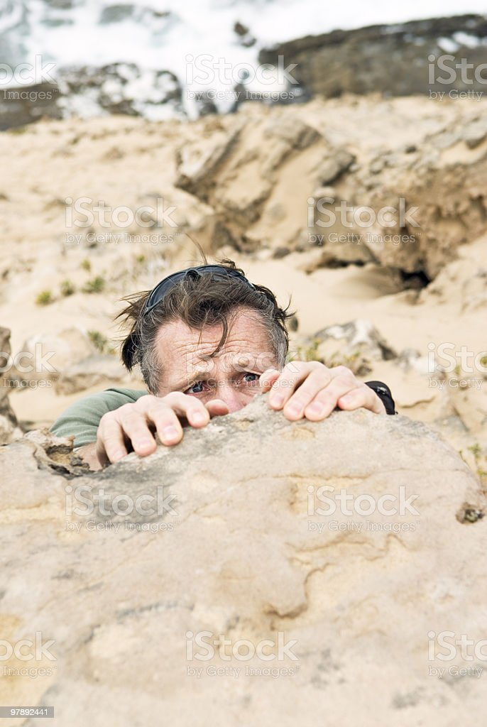 Man hanging on to cliff`s edge. royalty-free stock photo