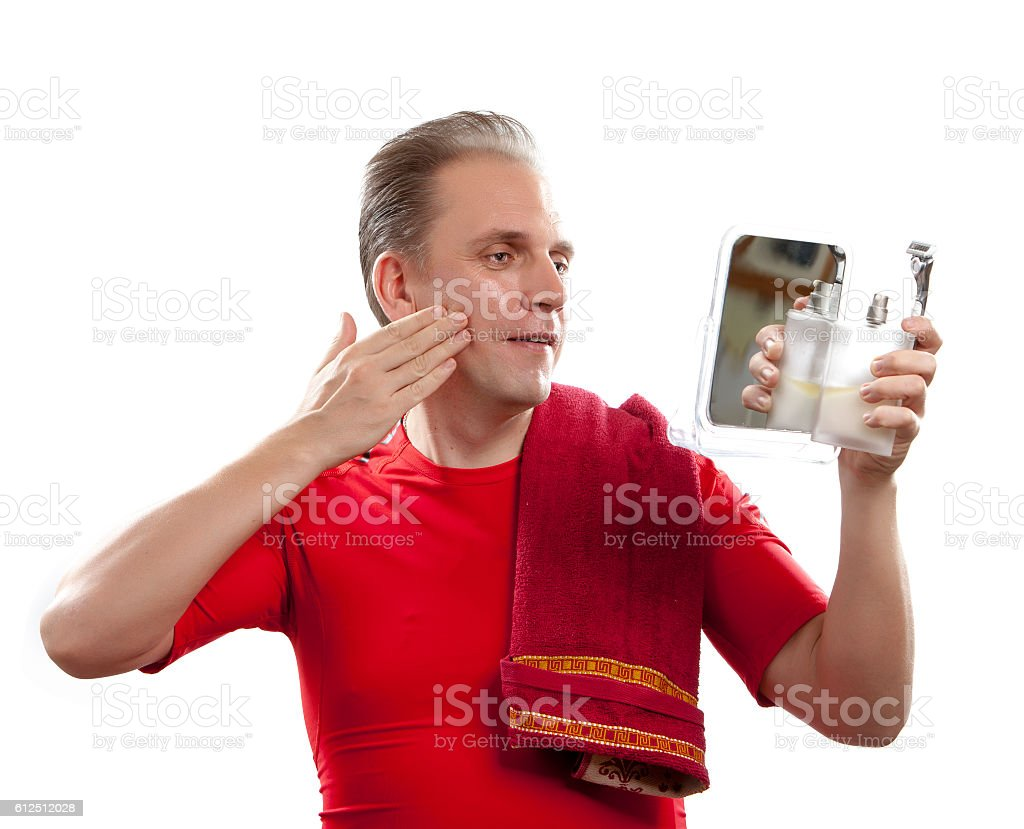 man has a shave with the razor stock photo