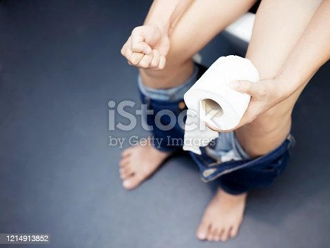 1045838148 istock photo A man has a stomach ache, excreting in the bathroom. 1214913852
