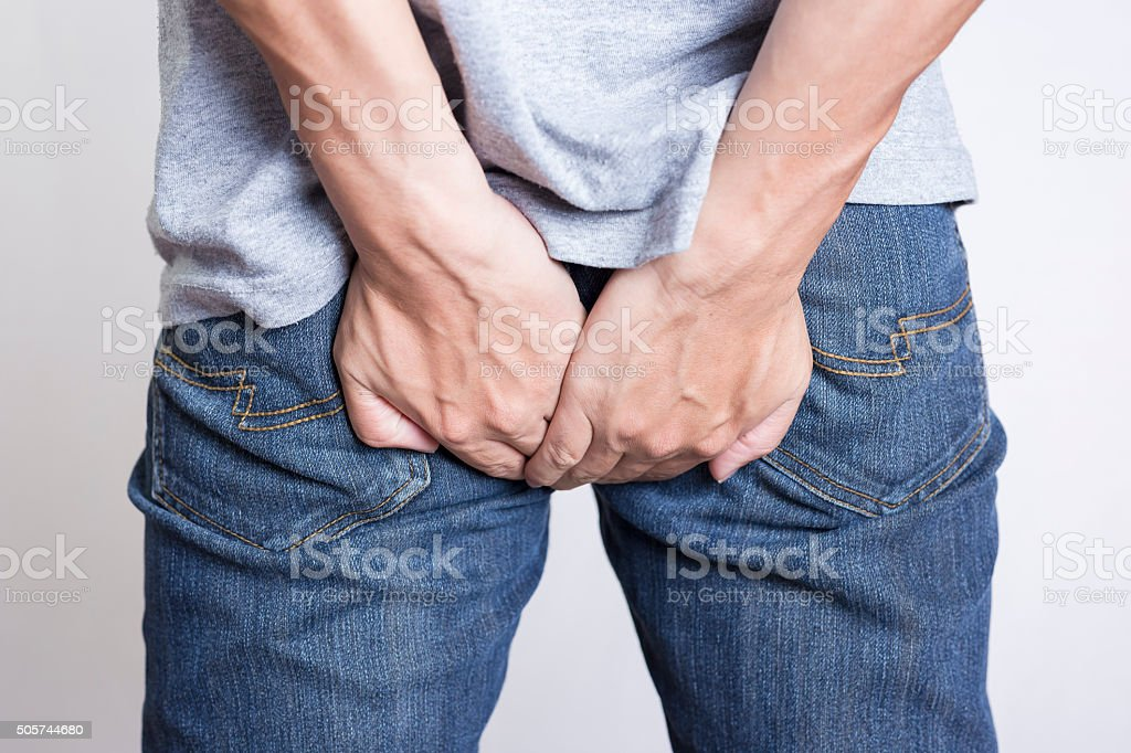 Man has Diarrhea Holding his Butt: Isolated on White Background stock photo