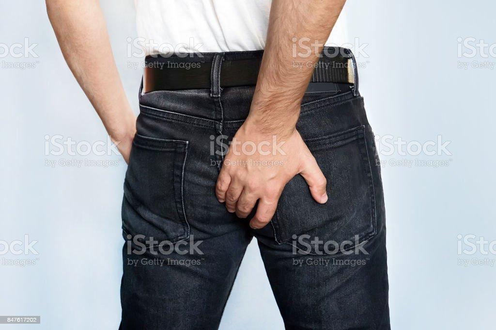 Man has Diarrhea Holding his Butt - foto stock