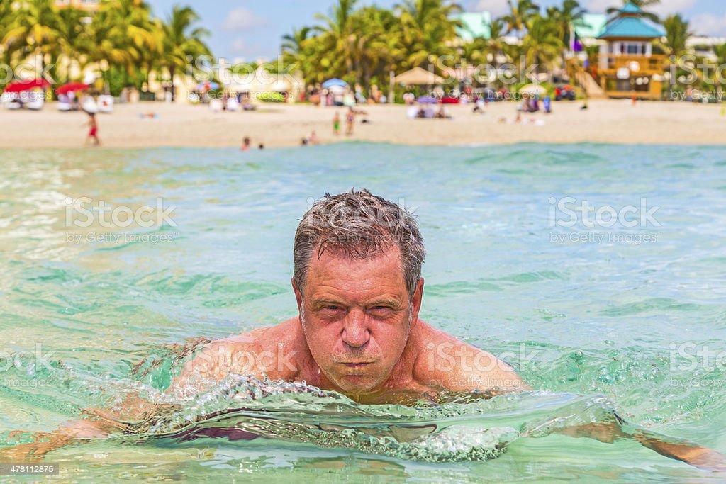 man has fun swimming in the ocean royalty-free stock photo