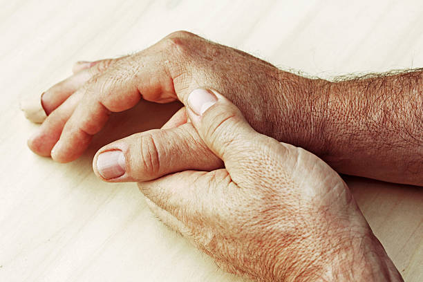 man has pain in his hand A man has pain in his hand gout stock pictures, royalty-free photos & images
