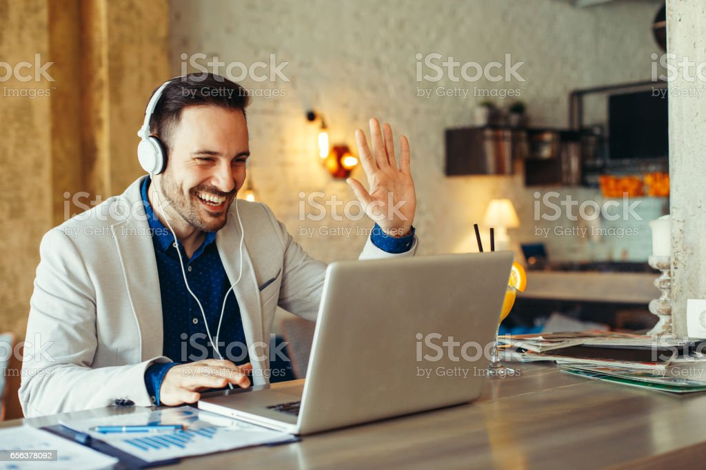 Man have business meeting via video call in a cafe stock photo