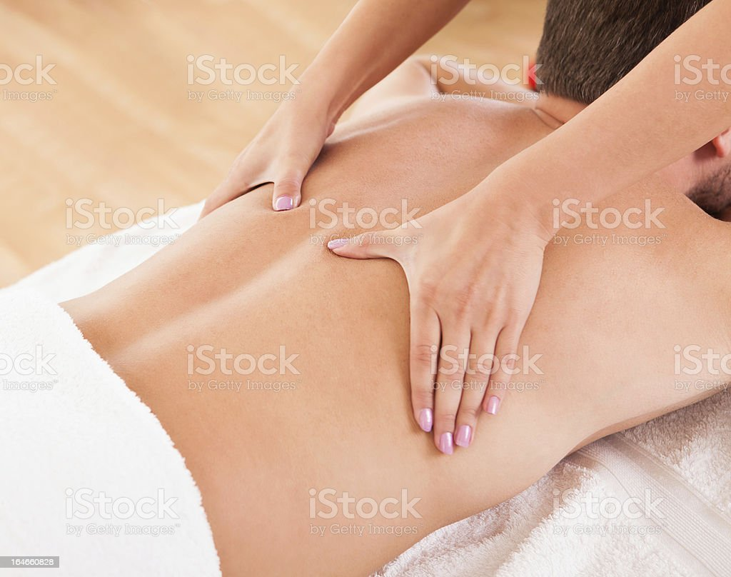 Man having a back massage royalty-free stock photo