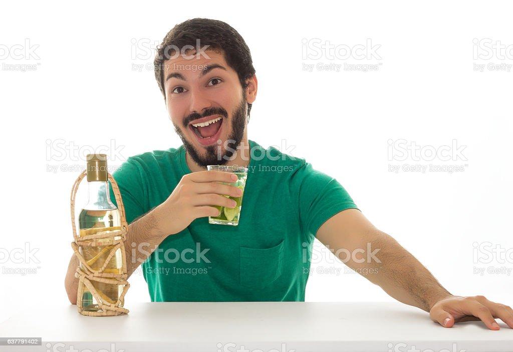 Man having a glass of caipirinha. stock photo