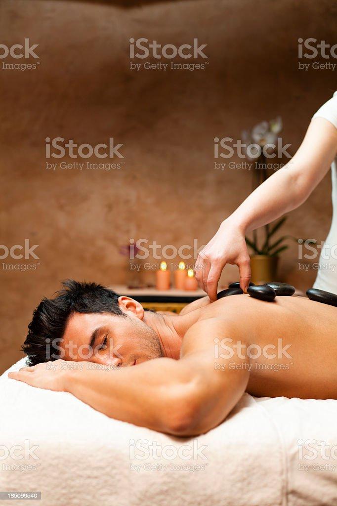 Man having a lastone therapy stock photo