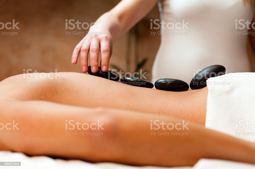 Man having a lastone therapy royalty-free stock photo