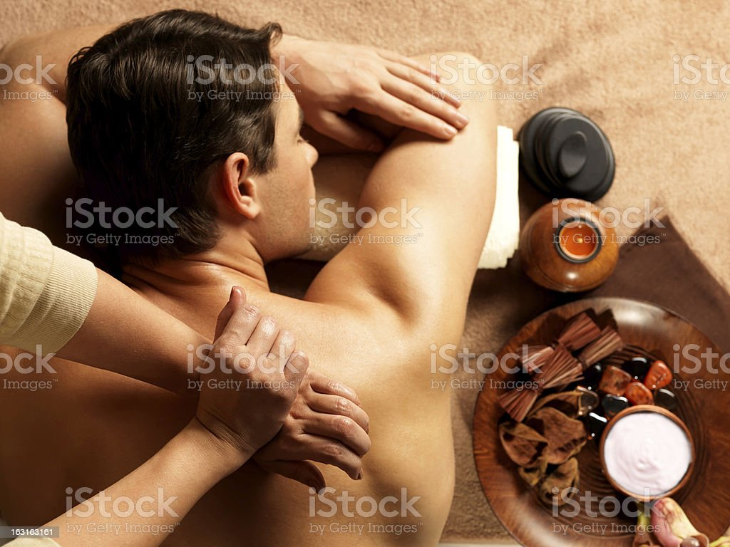 Man having a massage in spa salon royalty-free stock photo