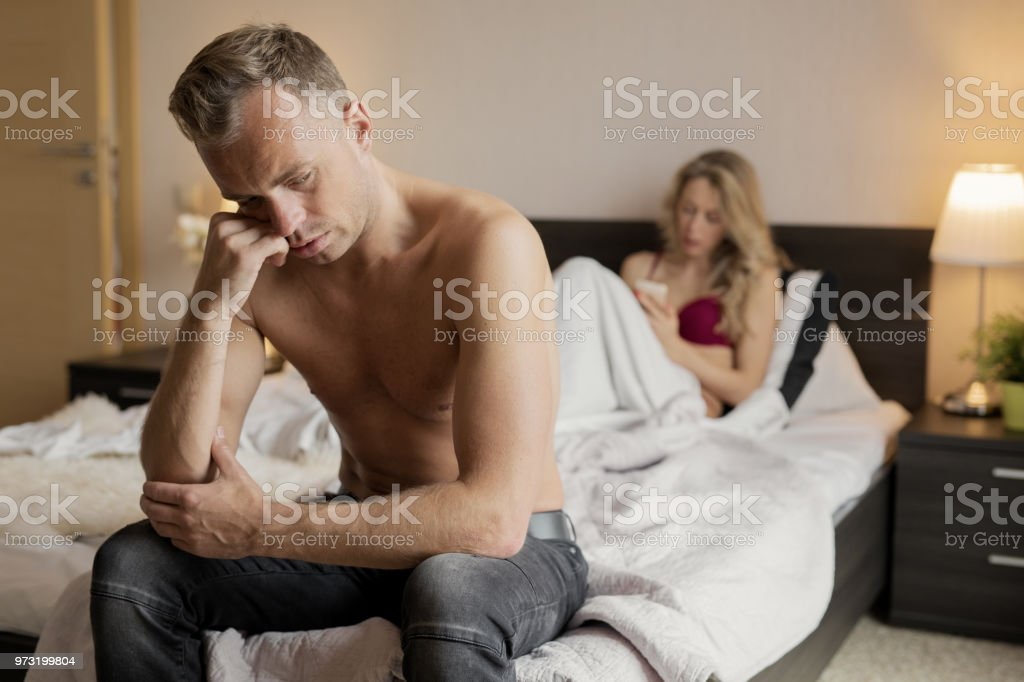 Man having a problem in bedroom stock photo