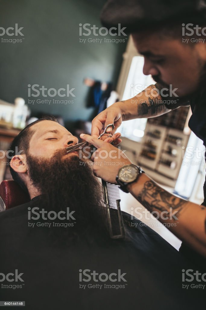 Man having a shave at the barber shop stock photo