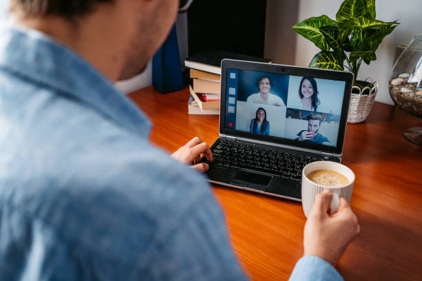 Man having a video call with friends stock photo