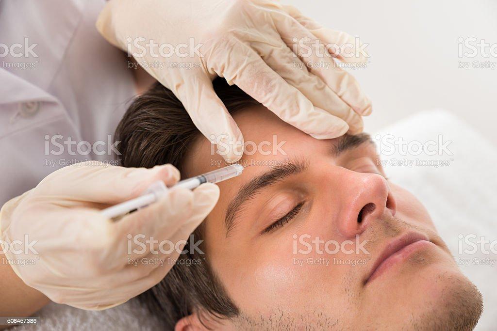 Man Having Botox Treatment stock photo