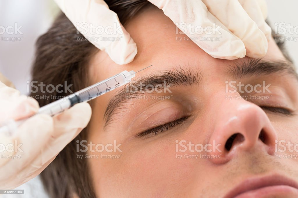 Man Having Botox Treatment stock photo