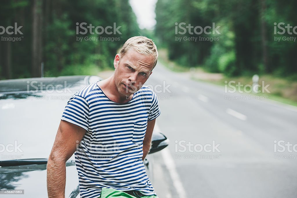 Man having car problem by the road stock photo