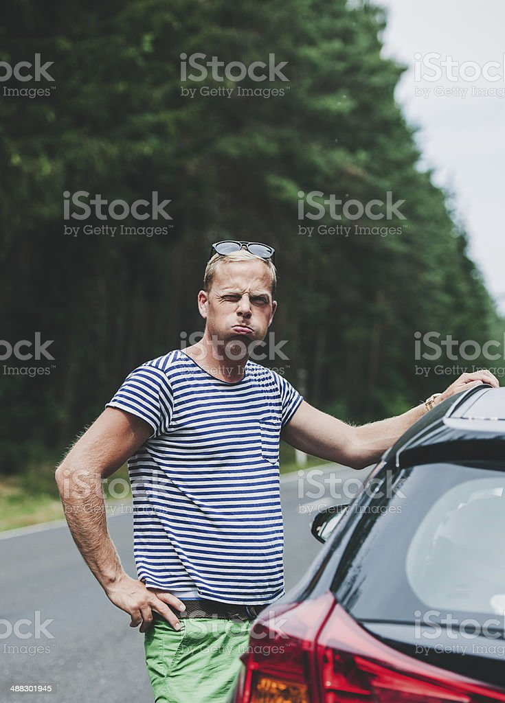 Man having car problem by the road