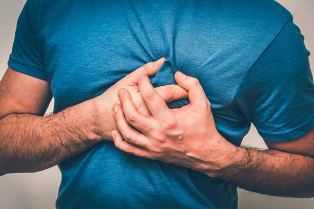 Man having chest pain, heart attack stock photo