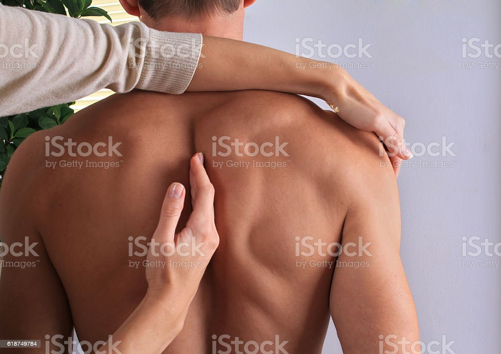 Man having chiropractic back adjustment close up. stock photo