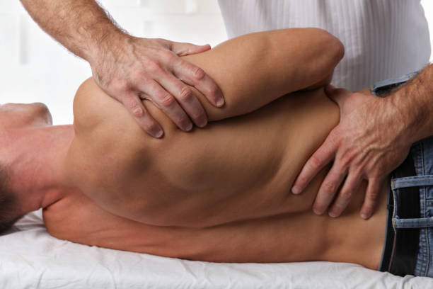 man having chiropractic back adjustment. osteopathy, physiotherapy, sport injury rehabilitation concept - sports medicine stock pictures, royalty-free photos & images