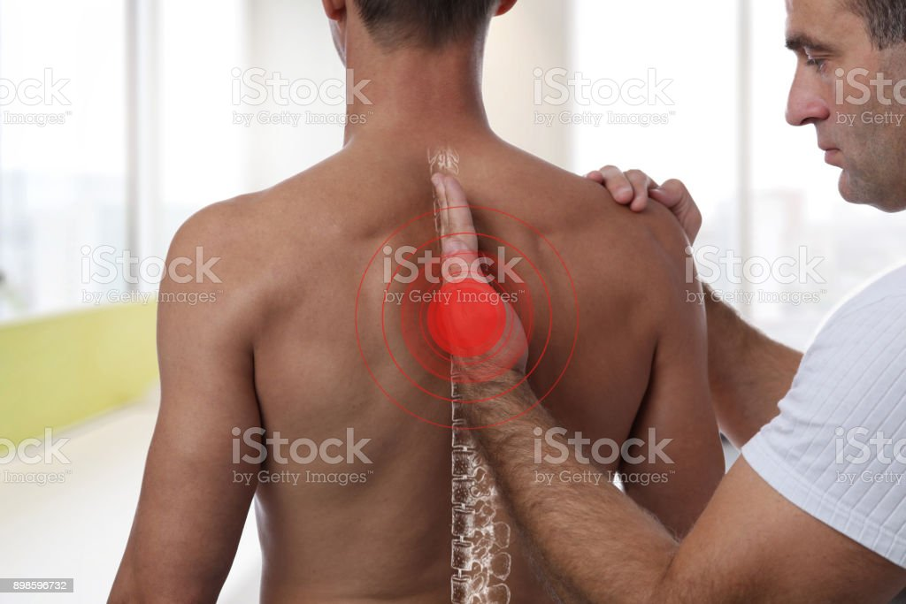 Man having chiropractic back adjustment. Osteopathy, Physiotherapy, sport injury rehabilitation concept stock photo