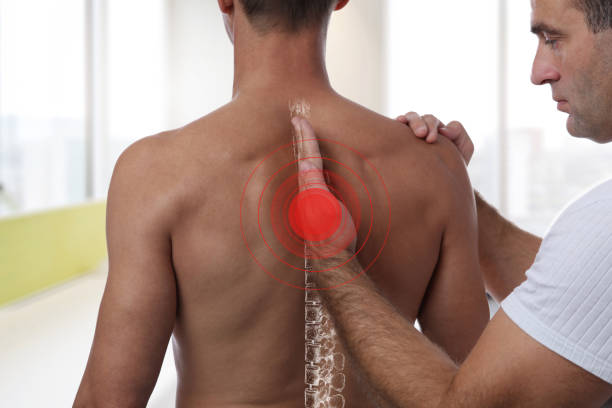 man having chiropractic back adjustment. osteopathy, physiotherapy, sport injury rehabilitation concept - osteopathy stock pictures, royalty-free photos & images