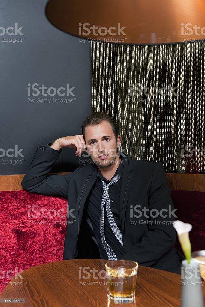 Man having drink in bar stock photo