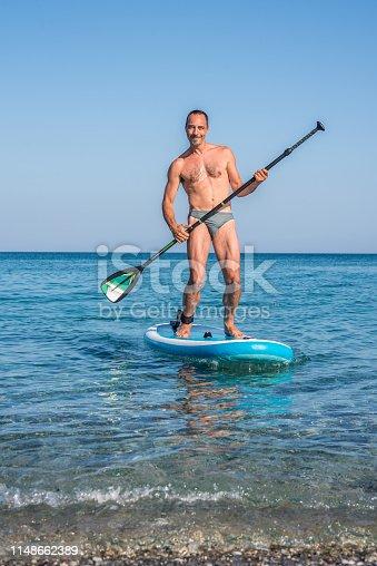 Man Having Fun on His Paddle Board