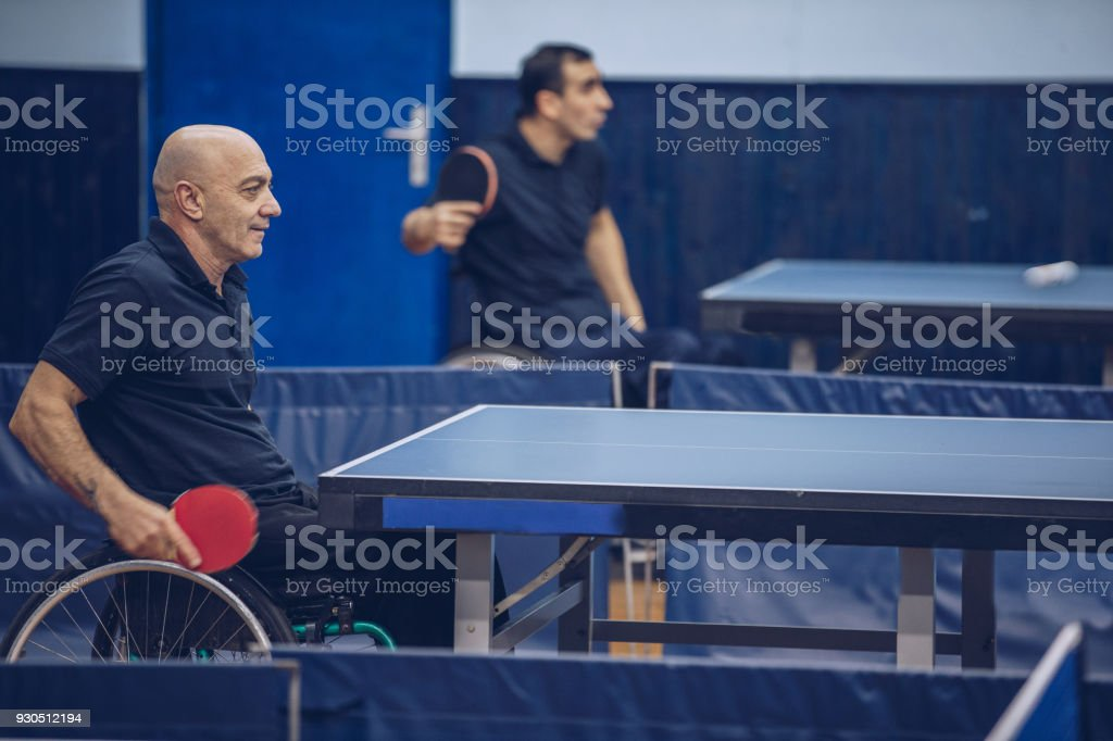 Man in a wheelchair playing table tennis