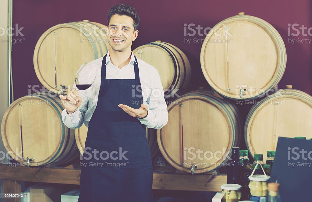 Man  having glass with wine sample in alcohol section stock photo