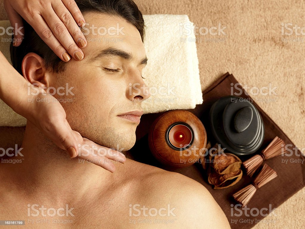 Man having head massage in the spa salon royalty-free stock photo
