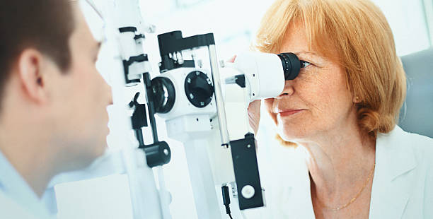 Man having his eyes examined. stock photo