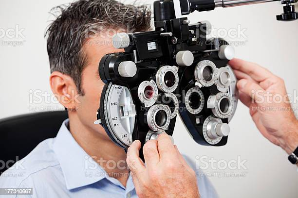 Man having his eyes examined with machine picture id177340667?b=1&k=6&m=177340667&s=612x612&h=wft0ouw1tskpwj2osw92txuluv934vafzqgdupqscve=
