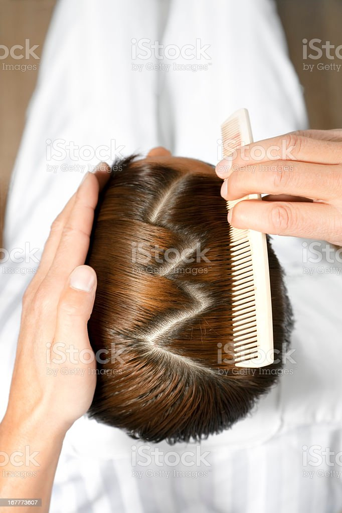 Man having his hair parted into a zigzag pattern stock photo