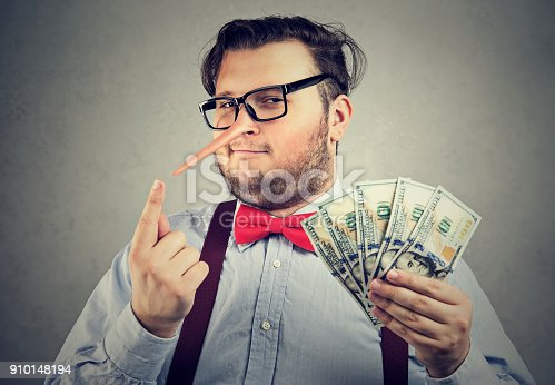 488389267istockphoto Man having illegally earned money 910148194