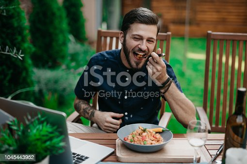 Man having lunch in a garden on a sunny summer day