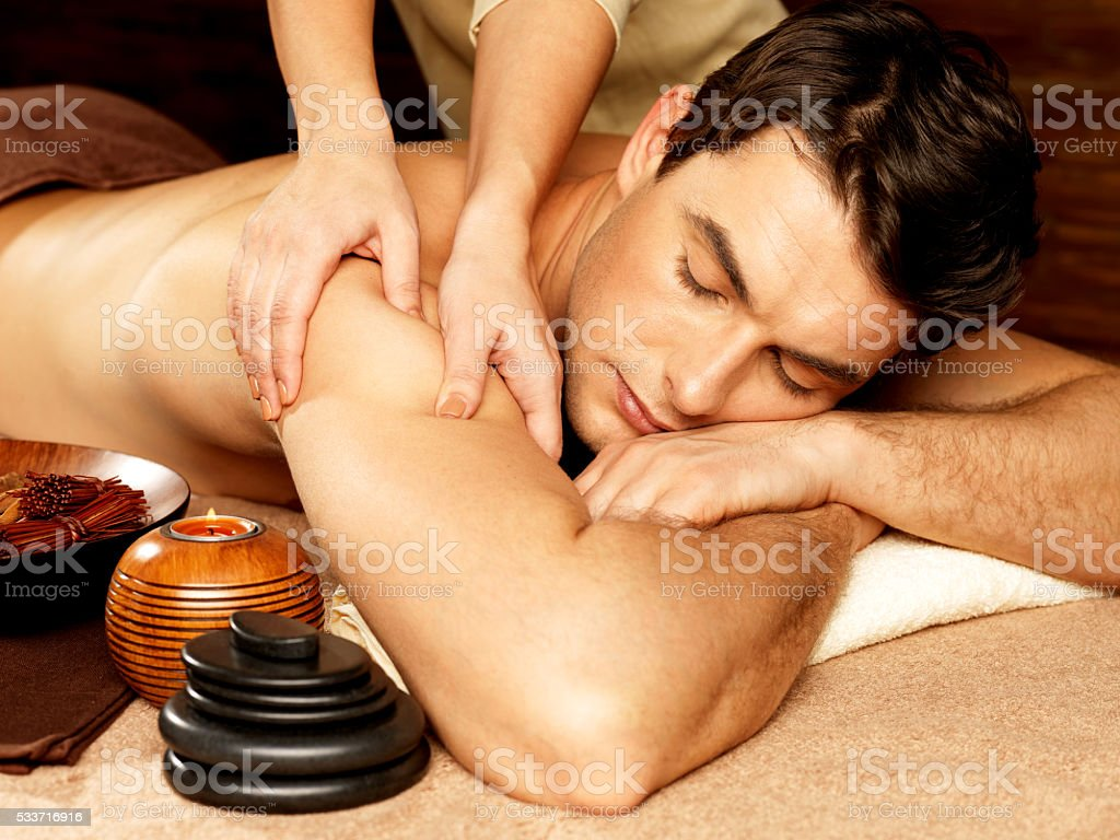 Man having massage in the spa salon stock photo
