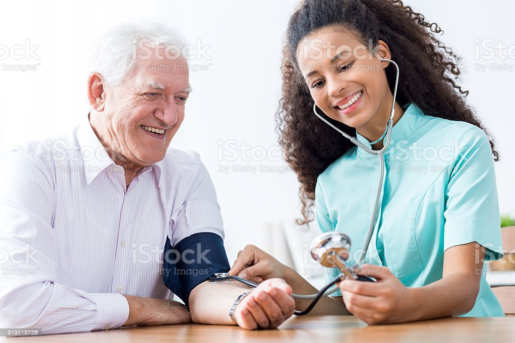 Man having measured blood pressure stock photo