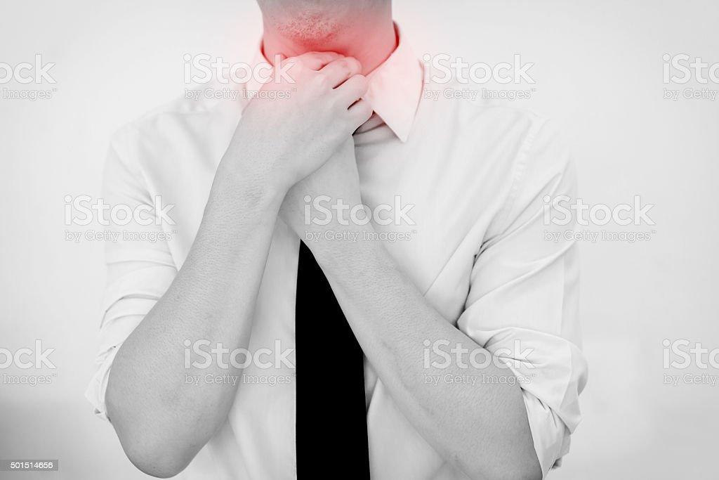 Man Having painful Sore Throat. Touching neck. Isolated white background stock photo