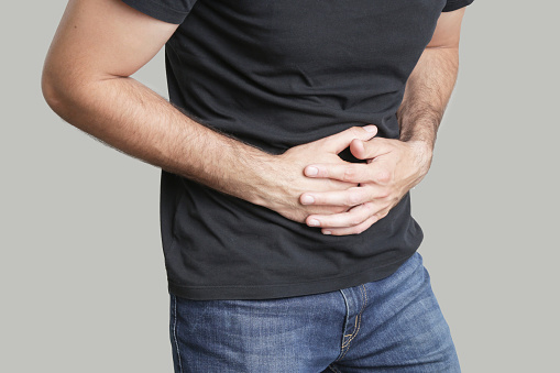 istock Man having painful stomach ache, chronic gastritis or abdomen bloating 968397888