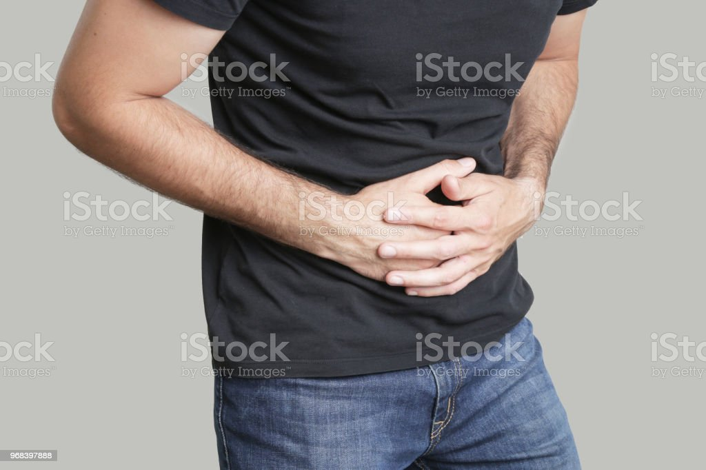 Man having painful stomach ache, chronic gastritis or abdomen bloating stock photo