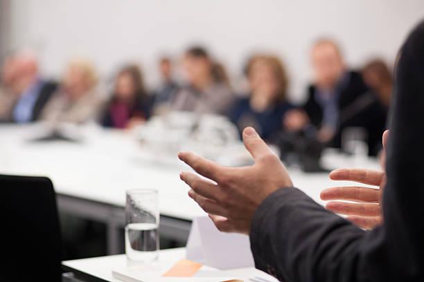man having presentation at seminar stock photo