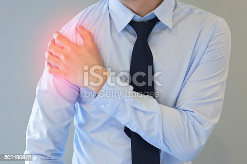 istock Man having shoulder pain problem with red spot 502486912
