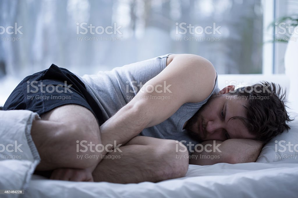 Man having sleep disorders stock photo