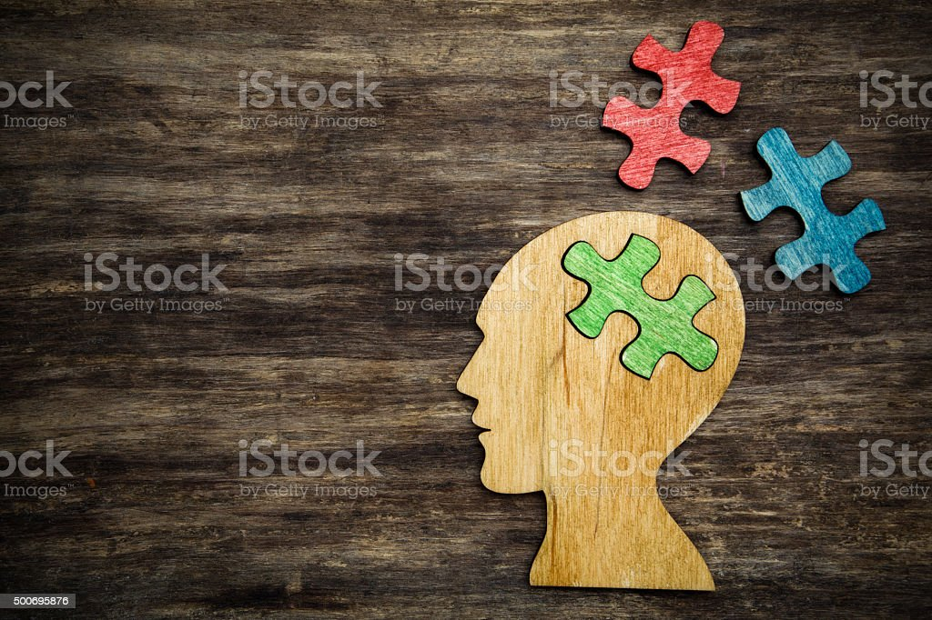 man head silhouette with jigsaw stock photo