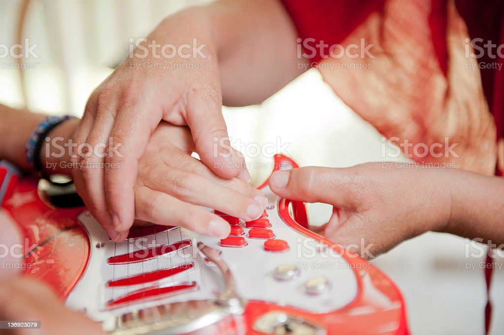 Man  helped to play guitar video game controller stock photo