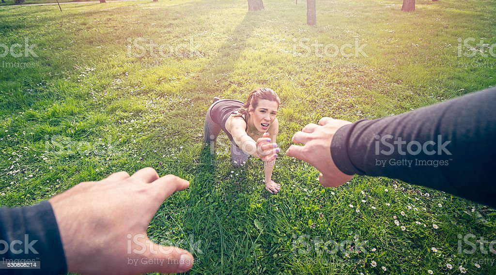 man helping girl in need stock photo