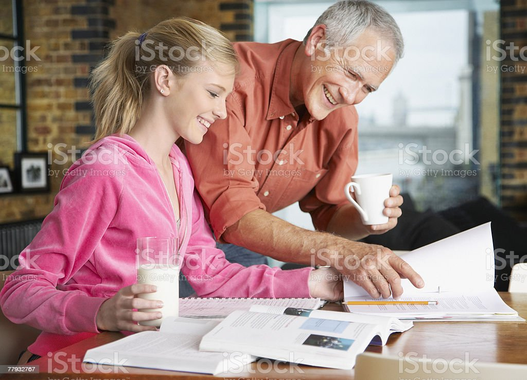 Man helping girl with homework royalty-free stock photo